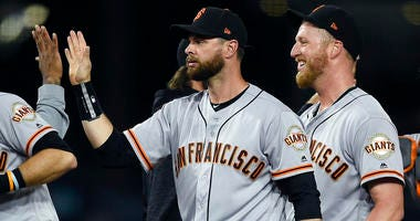 Giants rally to beat rival Dodgers 4-2 in series opener